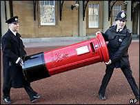 Policemen display post box in Buckingham Palace