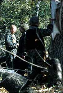 Omon troopers examine a tree damaged in fighting in Chechnya (photo from Valeri Gorban's archive)