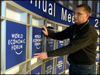 Workers putting up a WEF sign �World Economic Forum