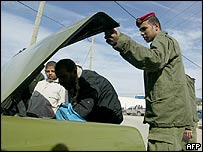 Palestinian security officer checks car in Beit Lahiya