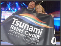 Millennium Stadium General Manager Paul Sergeant and singer Katherine Jenkins hold up a banner promoting the Tsunami Relief Cardiff concert