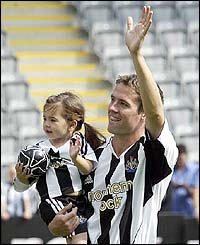 Owen is presented to around 20,000 thrilled Newcastle fan