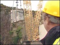Crane moves rock