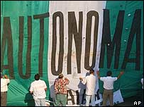 Protesters in Santa Cruz set part of a giant flag that reads Autonomy!