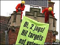 Activists suspend banner from Deputy Prime Minister John Prescott's roof, Getty