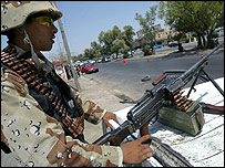 An Iraqi soldier mans a checkpoint