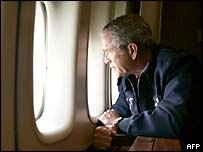 President Bush looks down from Air Force One as he flies over New Orleans
