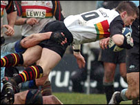 Dragons fly-half Ceri Sweeney takes the aerial route against Glasgow
