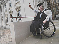 Photo of a wheelchair user wearing a mortar board