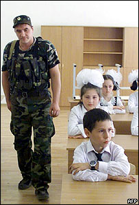 Chechen security officer checks a classroom in Grozny 31 August 2005
