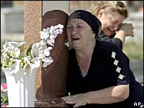 Women mourn in Beslan's cemetery ahead of the anniversary