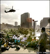 New Orleans residents watch helicopter near Superdome
