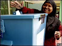 A Maldivian woman casts her ballot in Maldives parliamentary elections in Male.