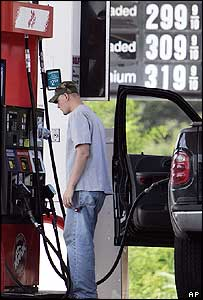 Man filling his truck up with petrol in the US