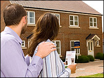 Homebuyers look at house