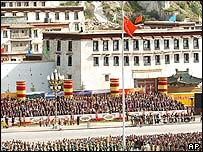 The national flag of China is hoisted at the celebration meeting place in Lhasa, capital of southwest China's Tibet Autonomous Region on Thursday, Sept. 1, 2005.