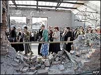 Mourners in the gutted gymnasium of Beslan's School Number &#079;ne