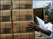 A volunteer unloads food parcels in Mobile