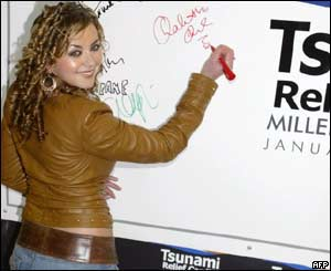 Charlotte Church signed her autograph on a poster at the Millennium Stadium concert.