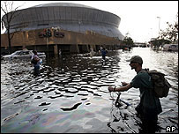 A man struggles past the Superdome in New Orleans