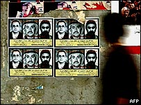Posters offering a reward for information about Zarqawi, Baghdad