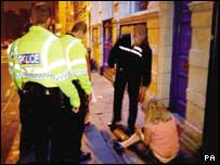 Police dealing with a drunk young person (generic picture)