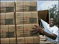 A volunteer unloads pre-packaged meals in Mobile, Alabama