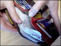 Person checking content of wallet