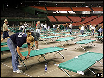Volunteers set up cots