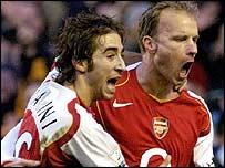 Dennis Bergkamp (right) celebrates scoring with Mathieu Flamini