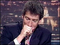 Jeremy Paxman struggling through a coughing fit