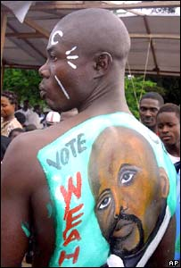 An image of a Liberian election candidate on a supporter's back, August 2005