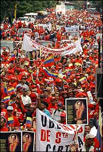 Supporters of Venezuelan President Hugo Chavez march in Caracas
