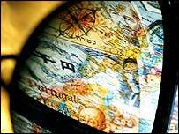 Currencies superimposed on a globe