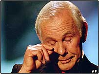 Talk show host Johnny Carson wipes his eye after watching a series of clips from earlier shows during the last taping of The Tonight Show