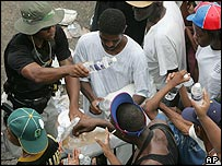 A Jefferson Parish Sheriff's deputy passes out bottles of water to some of the thousands of New Orleans residents