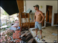 Michael Nickerson looks out the front of his home damaged by Hurricane Katrina