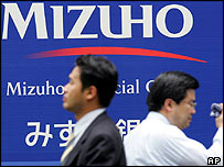 Businessmen outside the HQ of Japan's Mizuho Financial in Tokyo