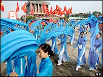 Vietnamese performers dance in front of former communist leader Ho Chi Minh's mausoleum during the 60th anniversary parade celebrating Vietnam's independence on Friday Sept. 2, 2005 in Hanoi.