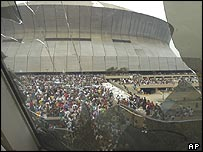 Crowds gather outside the Superdome