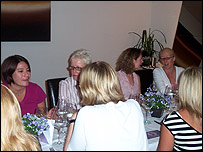 Women at a networking lunch