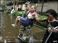 Louisiana National Guardsman carries woman from flood water in New Orleans