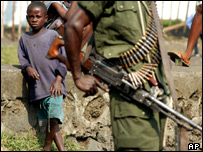 Boy looking at Congolese government soldier