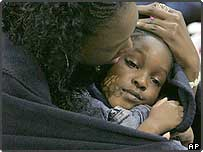 Hurricane Katrina refugee Roshonda Scott, comforts her four-year-old daughter Amari Price at a shelter at Reunion arena in Dallas