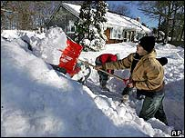 Resident of Hyannis, Massachusetts, clears snow