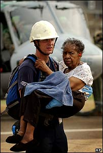 A woman being carried by a rescue worker