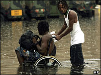 Hurricane Katrina refugees try make their way through rain and floodwaters in Louisiana