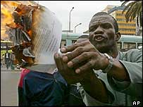 Kenyan demonstrator burns a draft copy of the constitution in Nairobi, Kenya
