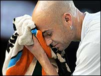 Four-time champion Andre Agassi was outplayed by his younger opponent