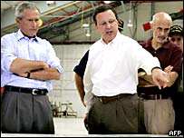 President George W Bush in Mobile, Alabama, with officials
